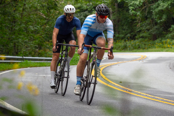 cyclists descending on bikes with eeBrakes
