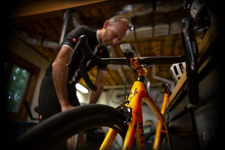 Man pumping tire of bike