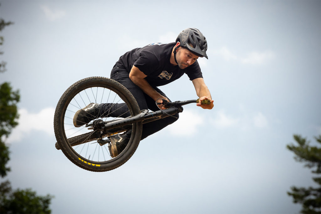 Rider doing a stunt on a bike with a Helm DJ fork